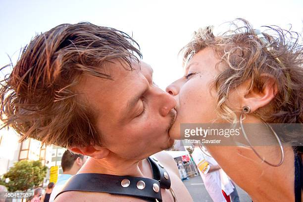 CONTENT] Couple making out at the annual Folsom Street Fair public display of affection french kiss kissing lovers couple man woman lip locked mouth...