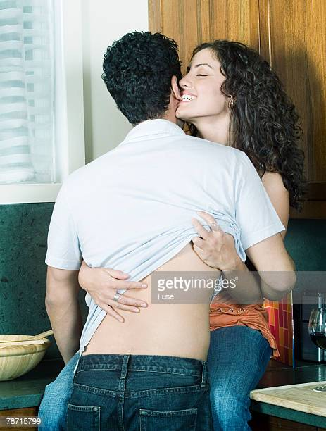 couple making out in the kitchen - earlobe stock photos and pictures