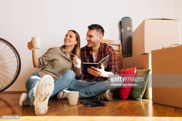 Couple making plans about their new room