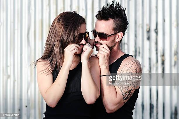 Couple making pretend mustaches