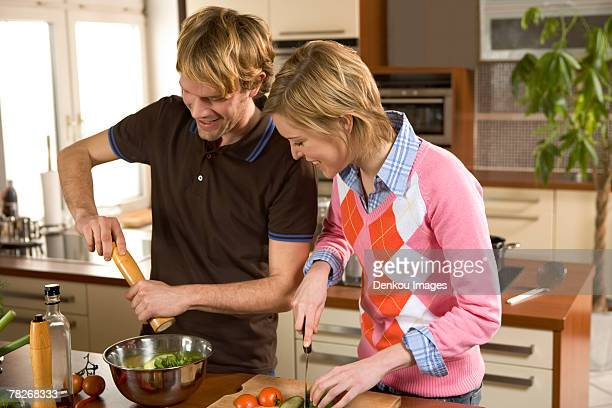 Couple making salad.