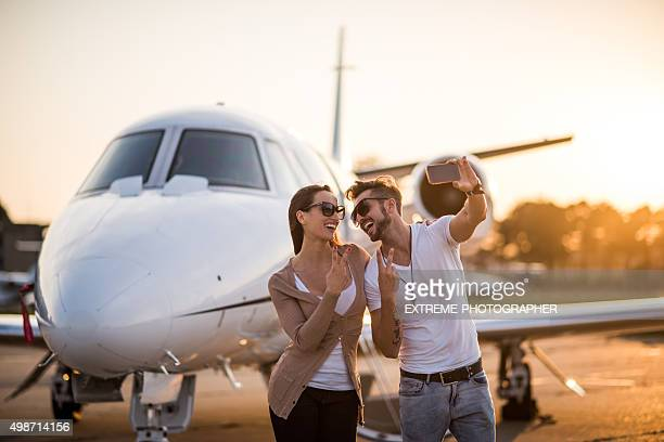 Couple making selfie at the airport