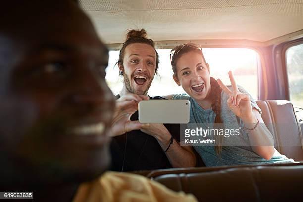 Couple making selfie inside car
