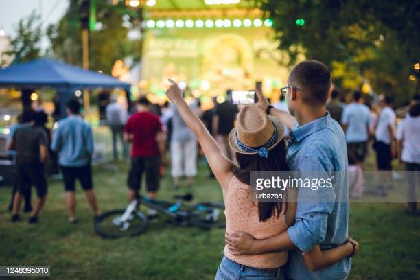 couple making selfie on a music festival - concert stock pictures, royalty-free photos & images