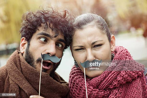Couple making selfie with mustaches