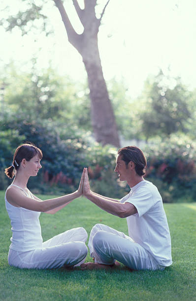 Couple meditating outdoors