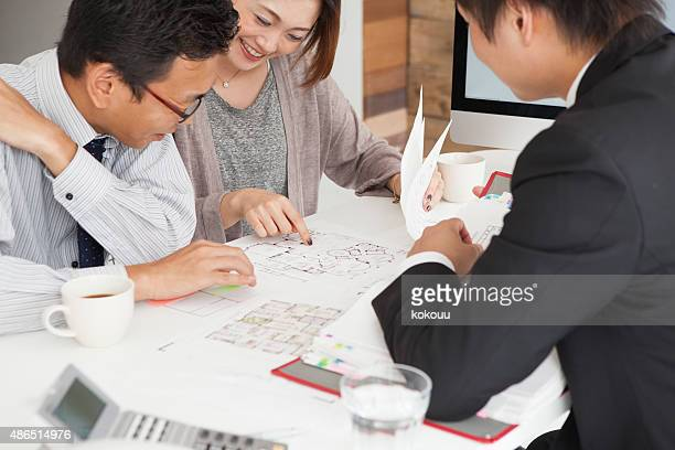 couple meeting architect for house construction - permission concept stock pictures, royalty-free photos & images