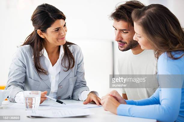 couple meeting with financial advisor - mortgage stock pictures, royalty-free photos & images
