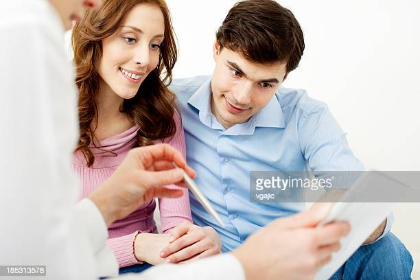 Couple Meeting With Financial Advisor.