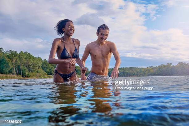 couple messing about in a lake in france - france stock pictures, royalty-free photos & images