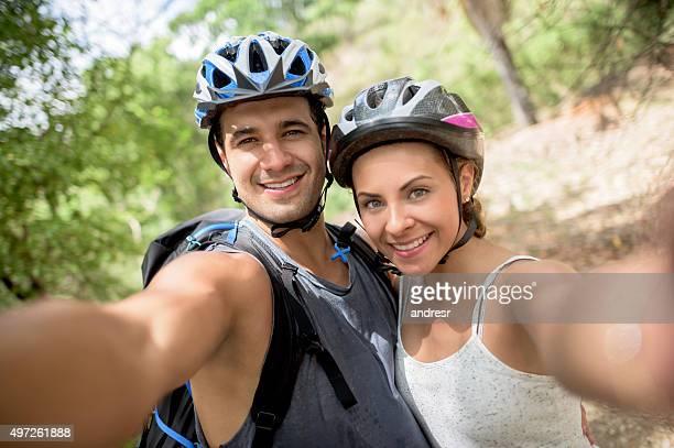 Couple mountain biking taking a selfie
