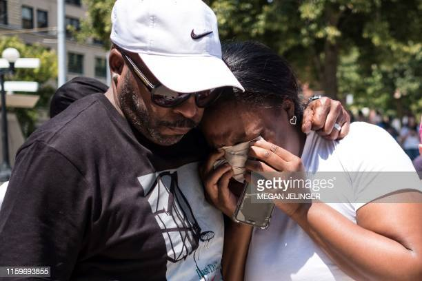 A couple mourn at a vigil held in honour of those who lost their lives during a shooting in Dayton Ohio on August 04 2019 Nine people were killed in...