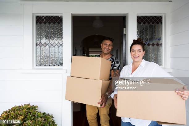Couple move packing boxes out of home