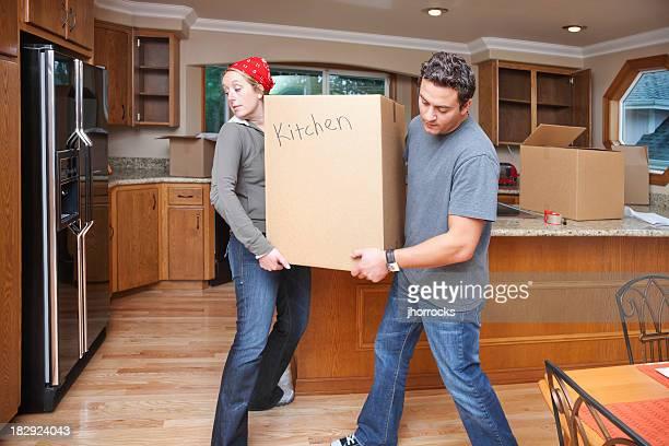 Couple Moving Heavy Box