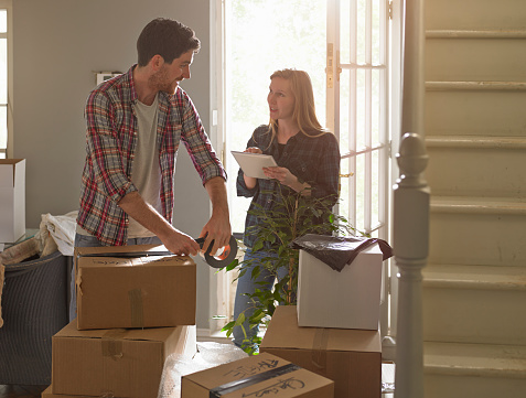 A couple moving home, the woman is using an iPad - gettyimageskorea