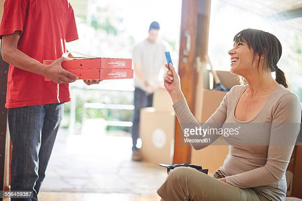 Couple moving house, collecting a pizza order