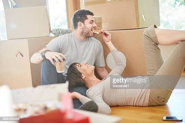 Couple moving house eating pizza