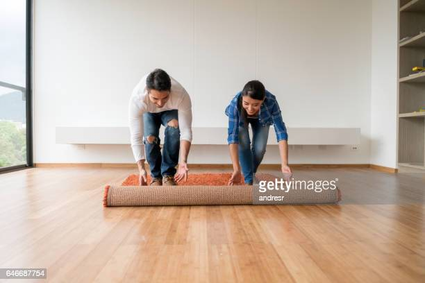 couple moving house - carpet decor stock photos and pictures