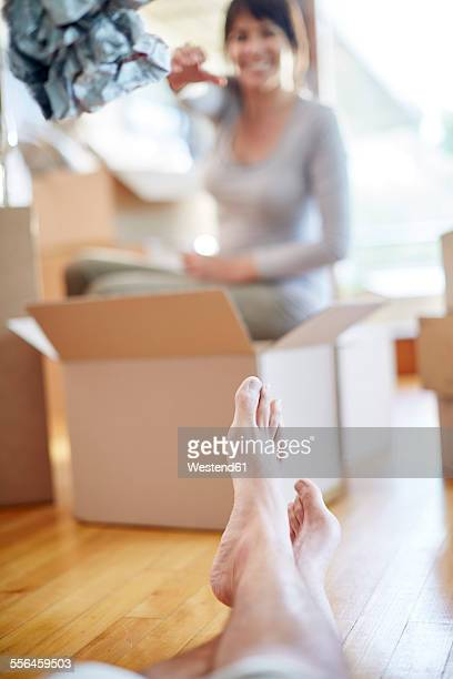 Couple moving house with boxes