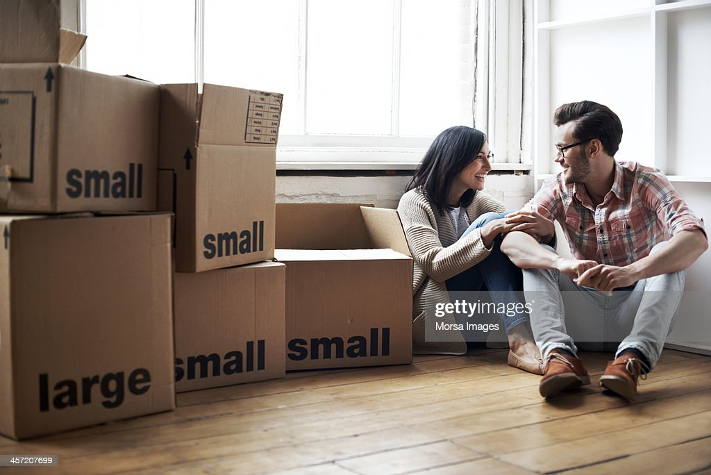 Couple moving into new flat : Stock Photo