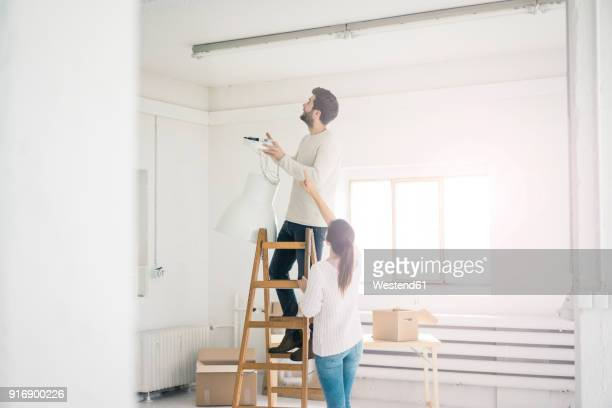 couple moving into new home - home improvement stock pictures, royalty-free photos & images