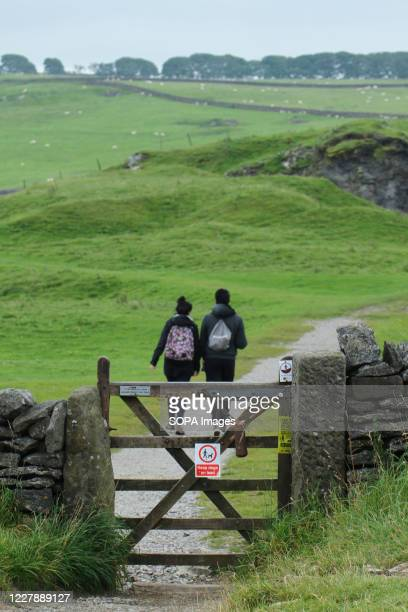 Couple navigate their hike at Hope Valley in the Peak district. With the predicted warm weather, people ventured outdoors amidst the novel...