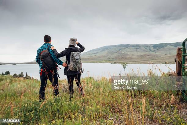 couple near dillon reservoir, looking at view, silverthorne, colorado, usa - close to stock pictures, royalty-free photos & images