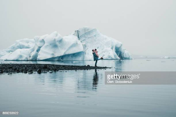 couple   near jokulsarlon lagoon - glacier lagoon stock photos and pictures