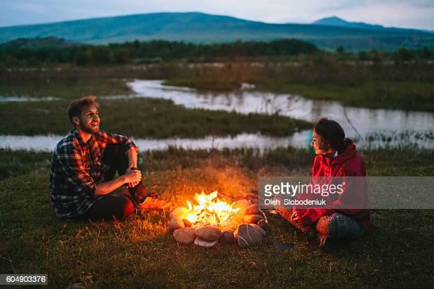 Couple near the campfire
