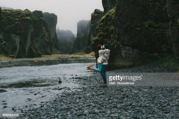 couple  near the river in fjaðrárgljúfur canyon - north stock pictures, royalty-free photos & images