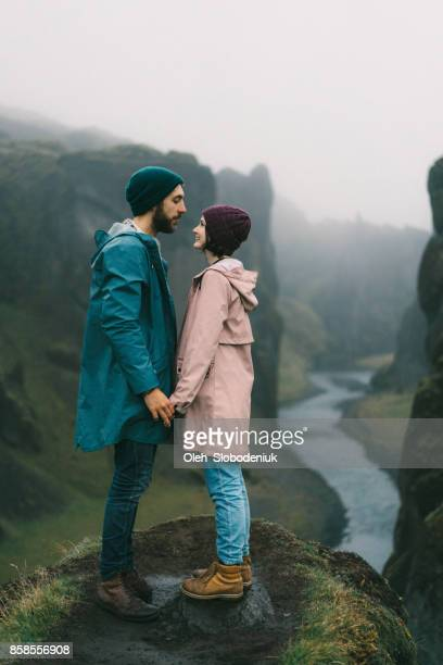 Couple  near the river in Fjaðrárgljúfur canyon