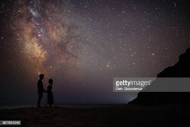 Couple near the sea under the starry sky