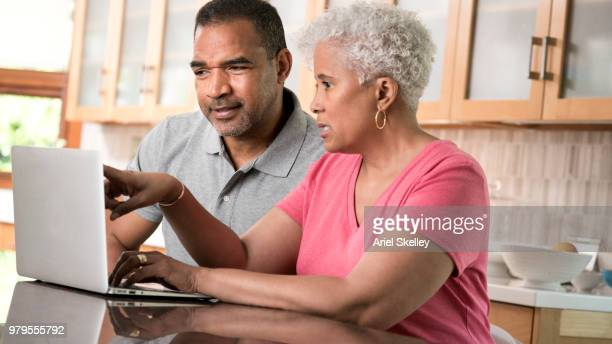 Couple Nervously Looking at Laptop