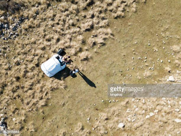 couple next to a tent from above - grass area stock pictures, royalty-free photos & images
