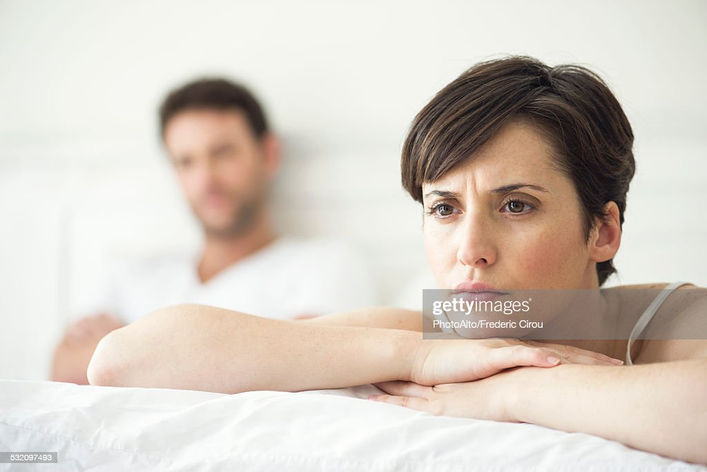 Couple not speaking after disagreement in bed : Stock Photo