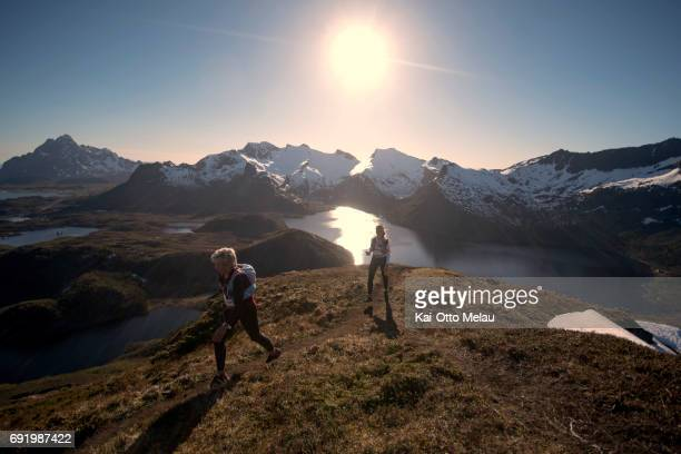 A couple of athlets slowly making their way over the last mountain at The Arctic Triple Lofoten Ultra on June 3 2017 in Svolvar Norway The Arctic...