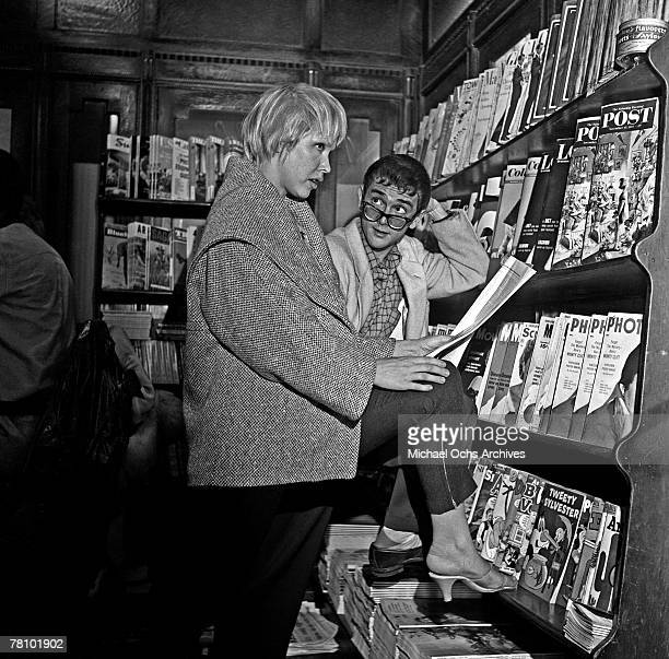 A couple of beatniks check out the magazines at a news stand on Sunset Boulevard on November 11 1954 in Los Angeles California