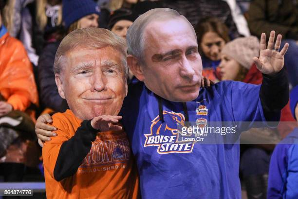 A couple of Boise State Broncos fans wear Donald Trump and Vladimir Putin masks during second half action between the Wyoming Cowboys and the Boise...