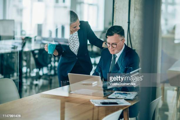 couple of business persons in the office - law stock pictures, royalty-free photos & images