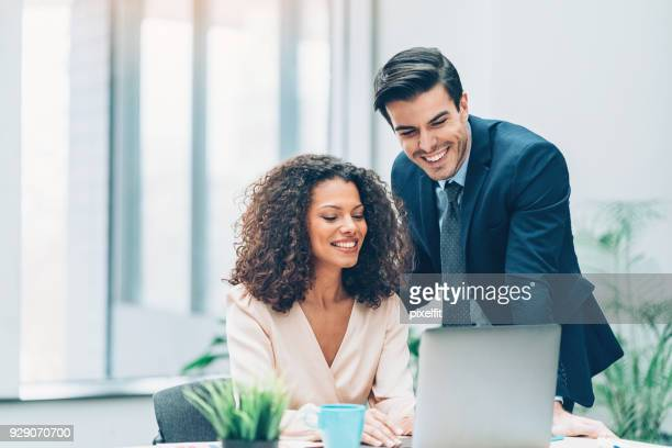 couple of business persons in the office - human relationship stock pictures, royalty-free photos & images