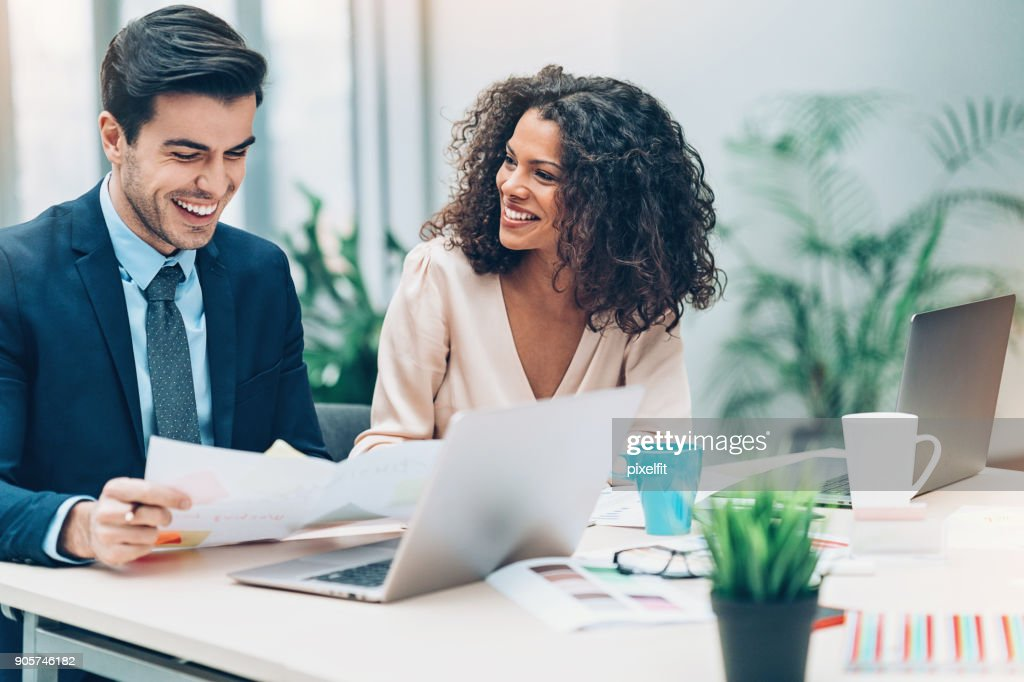 Couple of business persons on a meeting : Stock Photo