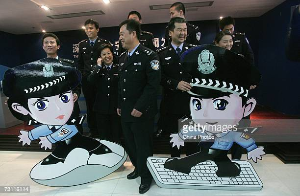A couple of cartoon online police officers respectively named 'Jingjing' and 'Chacha' are displayed with actual online police officers at the...