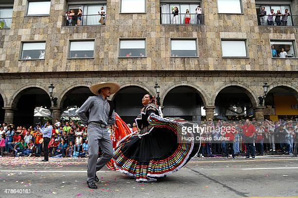 Couple of charros dance regional song during their participation in the parade of XX International Mariachi and Charreria in Guadalajara, Mexico....