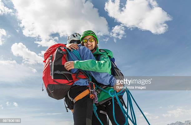 Couple of climbers giving a hug