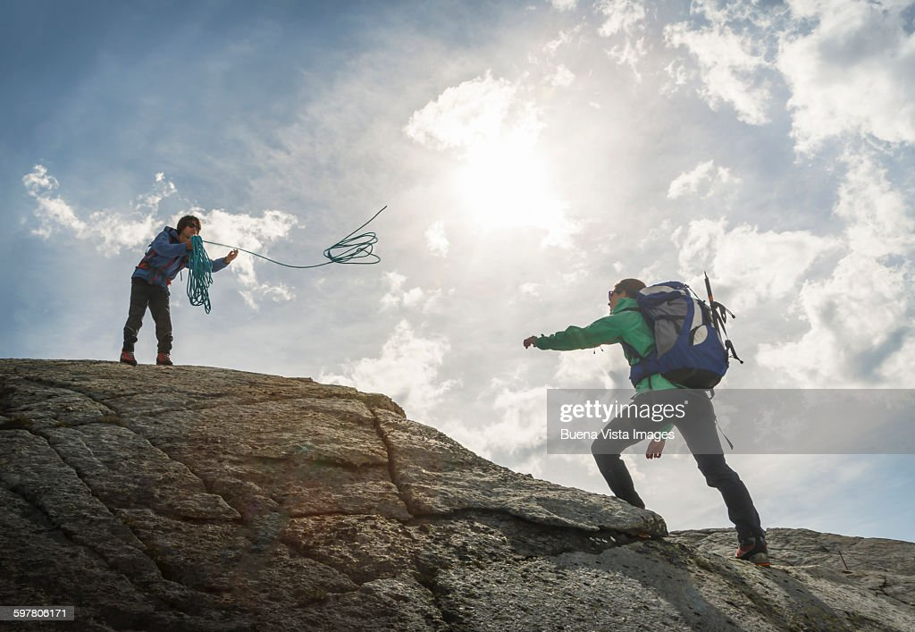 Couple of climbers in the mountains : Stock Photo