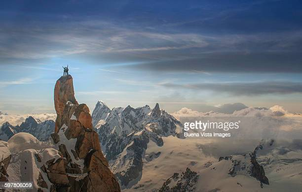 Couple of climbers on a mountaintop
