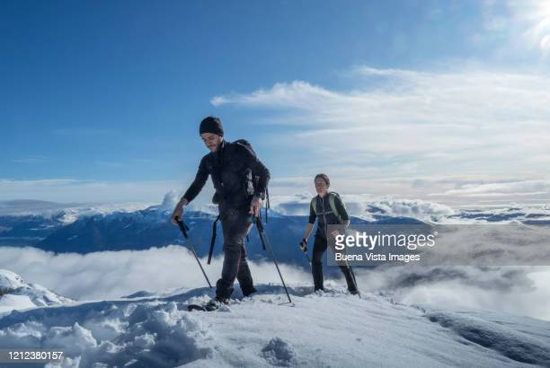 couple of climbers on a snowy slope - monte rosa foto e immagini stock