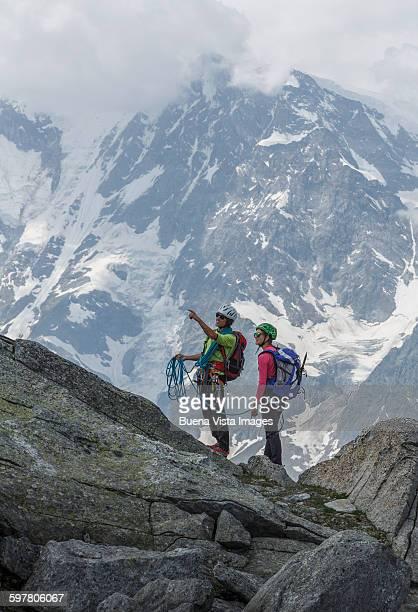 couple of climbers preparing for a climb - monte rosa foto e immagini stock