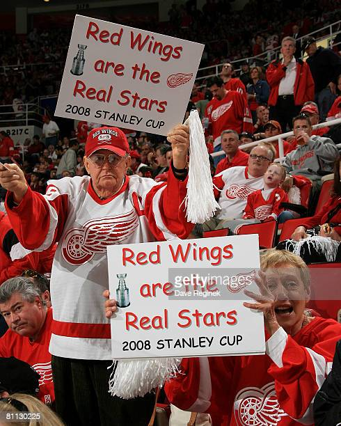 A couple of Detroit Red Wings fans show their signs during game five of the Western Conference Finals of the 2008 NHL Stanley Cup Playoffs against...