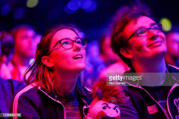 Couple of fans watch the games with a furry friend at the League of Legends World Championship on October 16, 2015 at the SSE Arena, Wembley in...